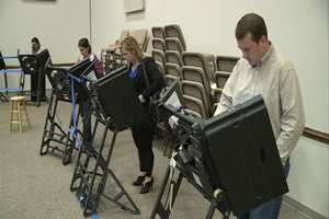 People voting at the Mt. Comfort Church of Christ in Fayetteville Tuesday morning.