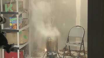 Smoke and flames started less than a second after the turkey was dumped in the fryer.