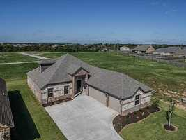 802 SW Caprington St., Bentonville, ARYour chance to live in a geothermal home! This community is striving to live green without sacrificing the amenities you expect. Amenities include: hardwood flooring, 3 cm granite counters, artistically tiled showers, stainless steel appliances w/ gas cook top, vented hood, surround sound, plumbed for central vac, crown molding. Save green by going green!