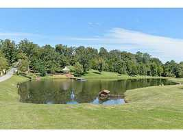 12007 Ridgefield Dr., Fort Smith, ARBeautiful 4 bedroom 3.5 bath home in a gated community with a stocked pond. Huge master suite with a private office and outdoor sitting area with a view of the pond. Master bath has heated tile floors and heated towel rack with a safe room in the closet, Beautiful kitchen with granite & stainless steel Kitchenaid appliances. Dining room and living room have wood floors and a limestone fireplace. Wet bar off the kitchen. Upstairs has a second living area and a bonus room.