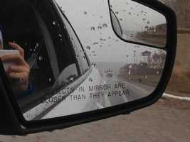 AHTD truck spotted in the passenger-side rear view mirror by 40/29 Reporter Emily Maher.