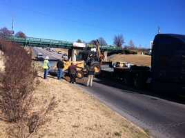 This backhoe fell off a trailer on Highway 71-B in Springdale Tuesday morning.