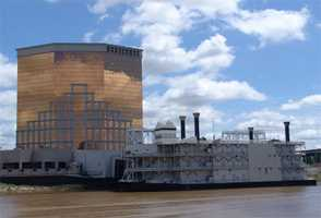Stay at a riverboat casino. Shreveport and Bossier City have six riverboat casinos and live horse track racing.