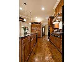 The home has wood, ceramic tile and carpeted floors.