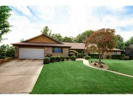1202 Timber Top Dr, Rogers, AR - $274,900CLOSE TO BEAVER LAKE!! AMAZING DEAL...brick & cedar home on almost 1 acre. Beautiful kitchen w/ built in desk, granite counter tops and lots of storage. Private lot, screened porch, deck, 2 living spaces, formal dining, oversized garage., Unfinished walk out basement. The master bedroom has 2 large closets. This house feels like a home as soon as you step through the door from its great brick fireplace to the updated kitchen&#x3B; this home has a lot to offer any family.