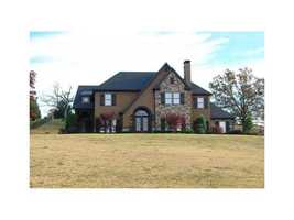 12023 Ridgefield Dr, Fort Smith, AR - $519,500Beautiful custom built one owner home in a private gated community with lake access and views. First floor master suite, sunroom with a double sided fireplace, office, media room, safe room, a professional chef's kitchen&#x3B; this is it!, This DREAM home will meet all of your living demands!