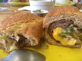 The Green Submarine Espresso Cafe & Sub Shop is in Fayetteville on Dixon Street! The Green Submarine features live music and great daily specials! Pictured is the Steak and Cheese Sandwich.