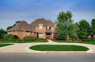 This luxurious custom built home located in the gated Pinnacle Subdivision is move-in ready! It has 4 bedrooms, a media room, huge closets and a safe room. It's located at 3 S Newhaven Court in Rogers.