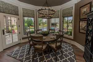 Gorgeous family dining area that overlooks the pool/patio/garden area.