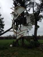 A barn blew into a tree in Evansville