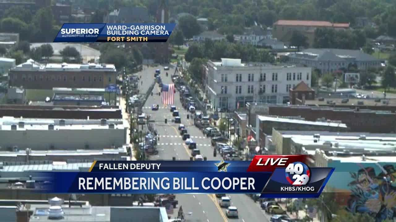 A procession led fallen deputy Bill Cooper's body to Oak Cemetery after his funeral Tuesday morning.