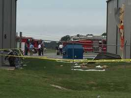 This photo shows where the plane crashed into a hangar.