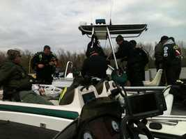 Arkansas Game and Fish dive team suiting up on the Arkansas River near Cecil.