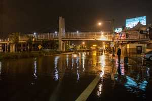 This photo provided by Dylan Patrick shows flooding along the Westside Highway near the USS Intrepid as Sandy moves through the area Monday, Oct. 29, 2012 in New York. Much of New York was plunged into darkness Monday by a superstorm that overflowed the city's historic waterfront, flooded the financial district and subway tunnels and cut power to nearly a million people.