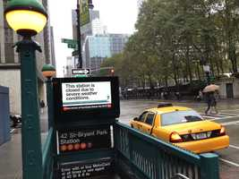 A sign at this subway station on 6th Avenue in New York City warns passengers the subway is closed due to Hurricane Sandy.