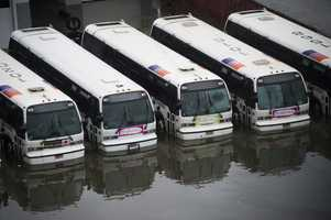 NJ Transit busses sit in flood water as a result of Hurricane Sandy on Tuesday, Oct. 30, 2012 in Hoboken, NJ.