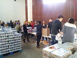 Volunteers make quick work of repackaging food items at CityHarvest in New York