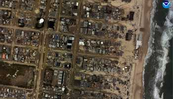 """Seaside Heights, New Jersey. """"Before"""" image captured by Google&#x3B; """"After"""" image captured by NOAA's National Geodetic Survey."""