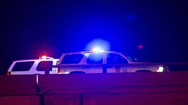 Kansas City, Kan., police said both drivers were killed when a man driving in the wrong direction on Interstate 70 with his lights off hit another car head-on.