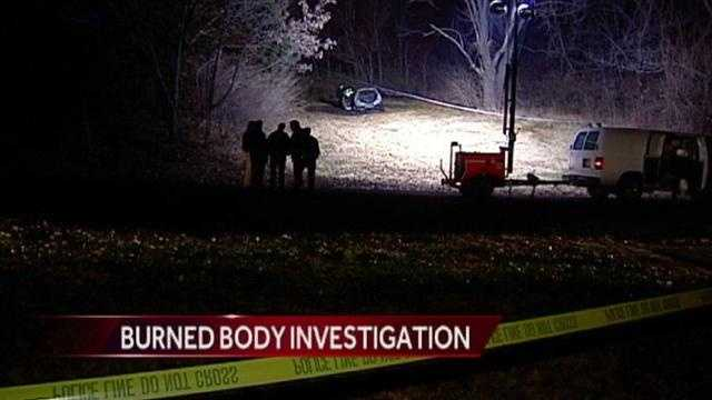 Kansas City, Kan., police said they have arrested one man and are looking for another in connection with the discovery of a body in a burned car last Saturday night.