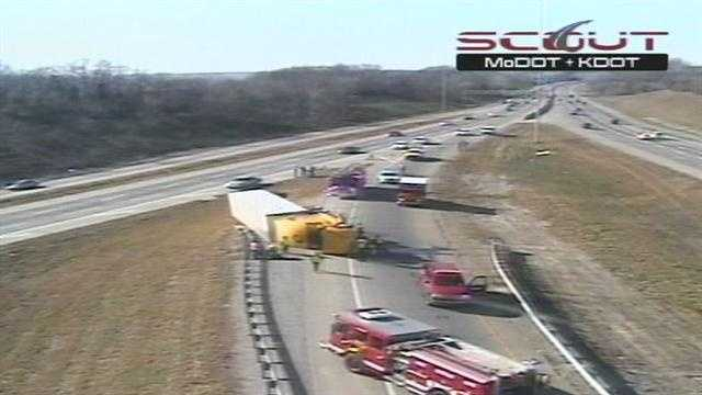 Tractor trailer flips, closes I-70 ramp