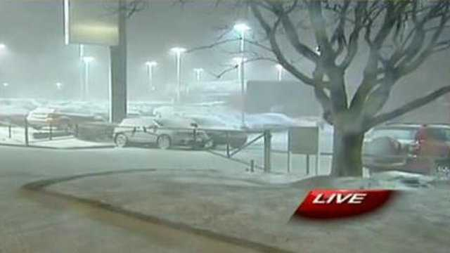 Snow at car dealership