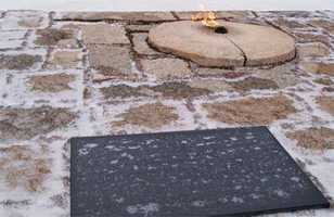 An eternal flame burns at John F. Kennedy's grave in Arlington National Cemetery.