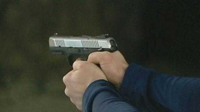 Image generic hand holding gun
