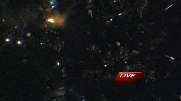 Firefighters comb through debris of the explosion, looking for possible victims.