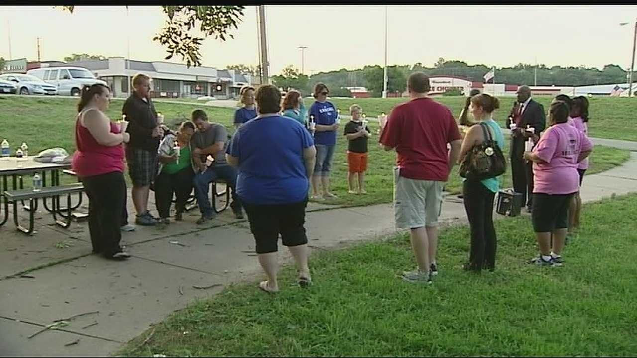 The Rev. Thomas Dean's family and friends held a vigil Friday night.