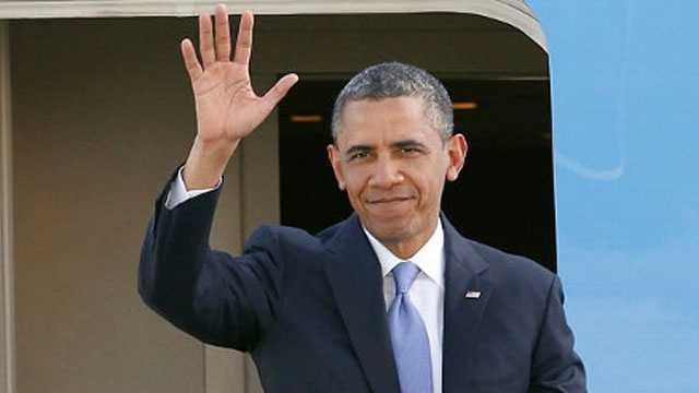 Image Obama waves