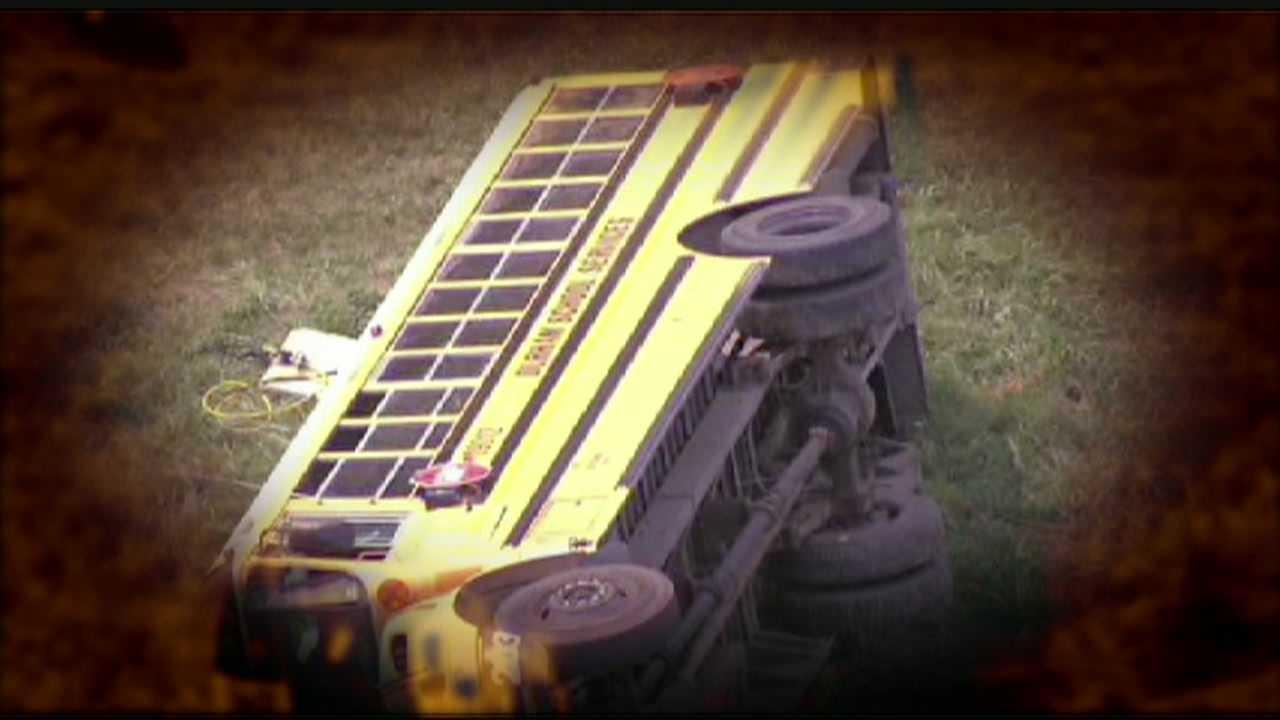 School bus overturns on ramp at K-7, K-32