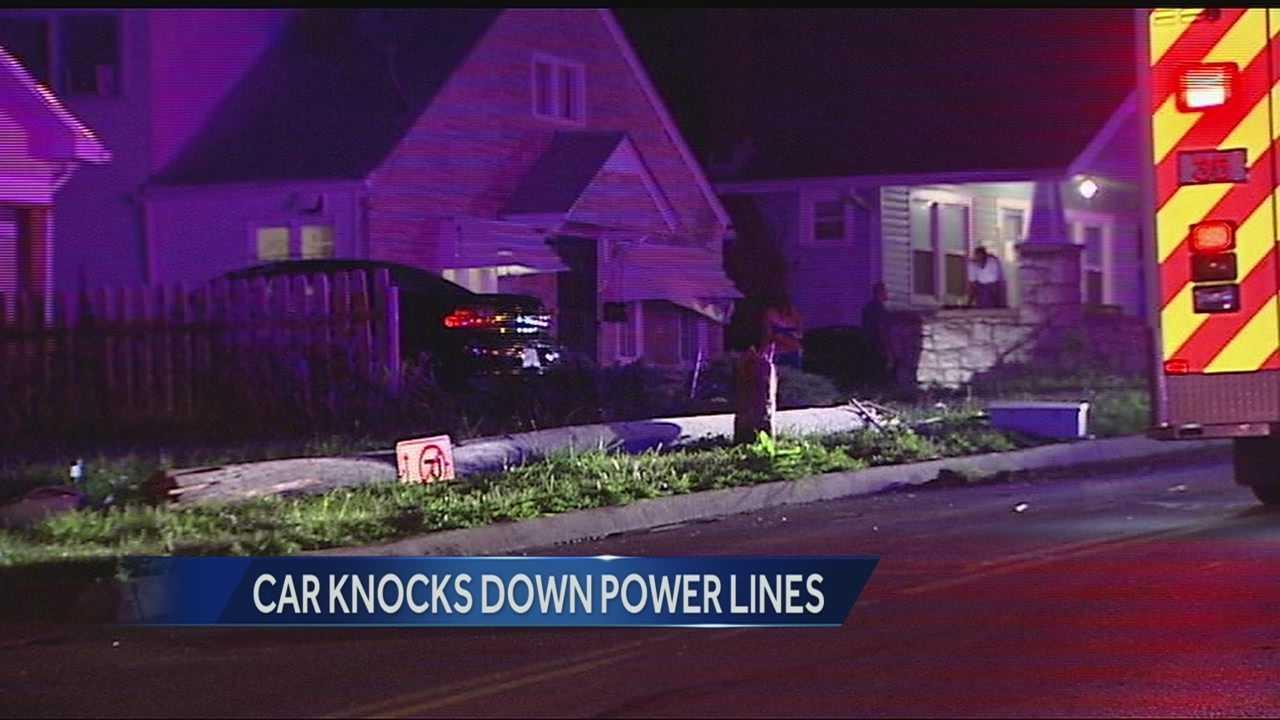 Car knocks down power pole, 38th, Cleveland
