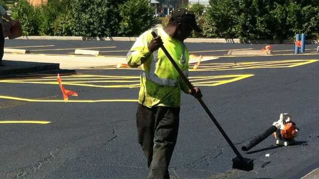 Image Parking lot being resurfaced in heat