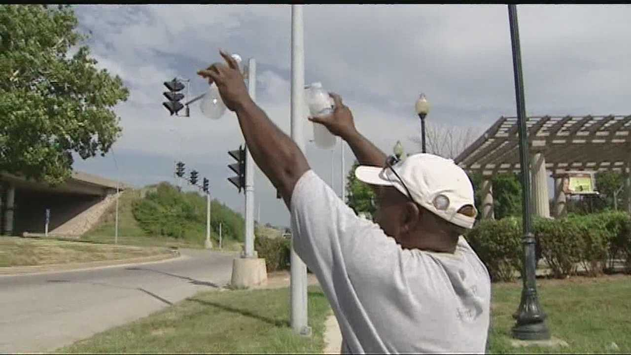 Image man provides bottled water to homeless