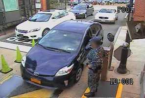 Alexis drives his rental car, a blue Toyota Prius, through the Washington Navy Yard main gate. (FBI)
