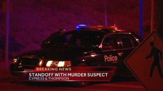 Homicide suspect in custody after standoff