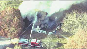 Images from NewsChopper 9 HD of a large house fire off of I-435 at Cookingham Drive and Skyview Avenue.  The fire happened Thursday afternoon at about 3 p.m.
