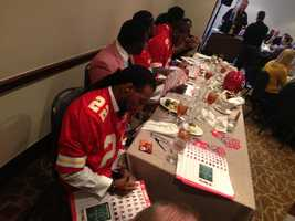 Dexter McCluster and Chiefs players sign autographs for luncheon attendees.