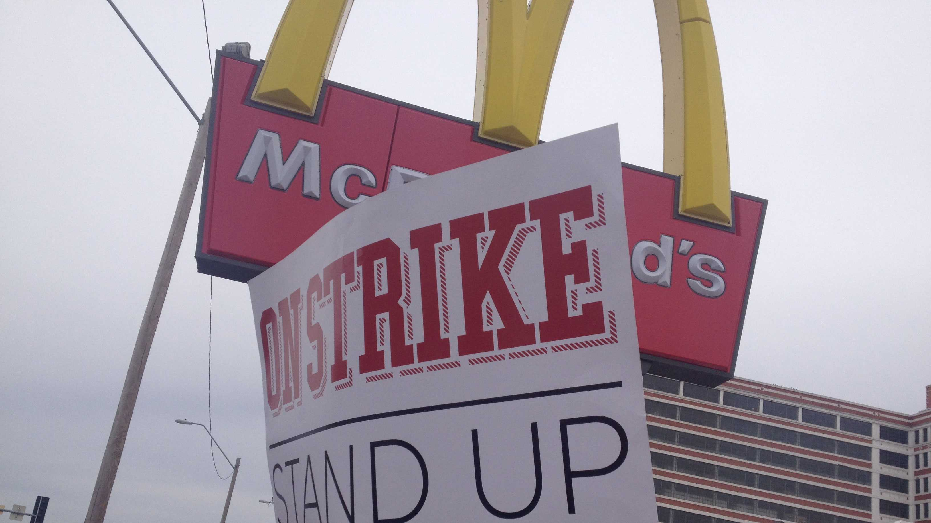 Fast-food workers protest, sign