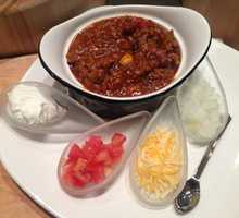 Spicy homemade beef chili served in a cup, bread bowl, or steaming hot baked potato.