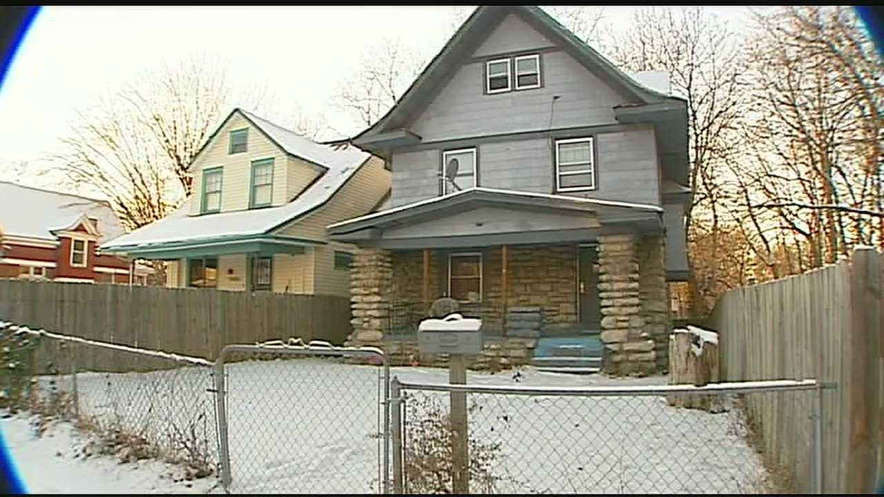 Adults arrested after child found outside home in cold temps