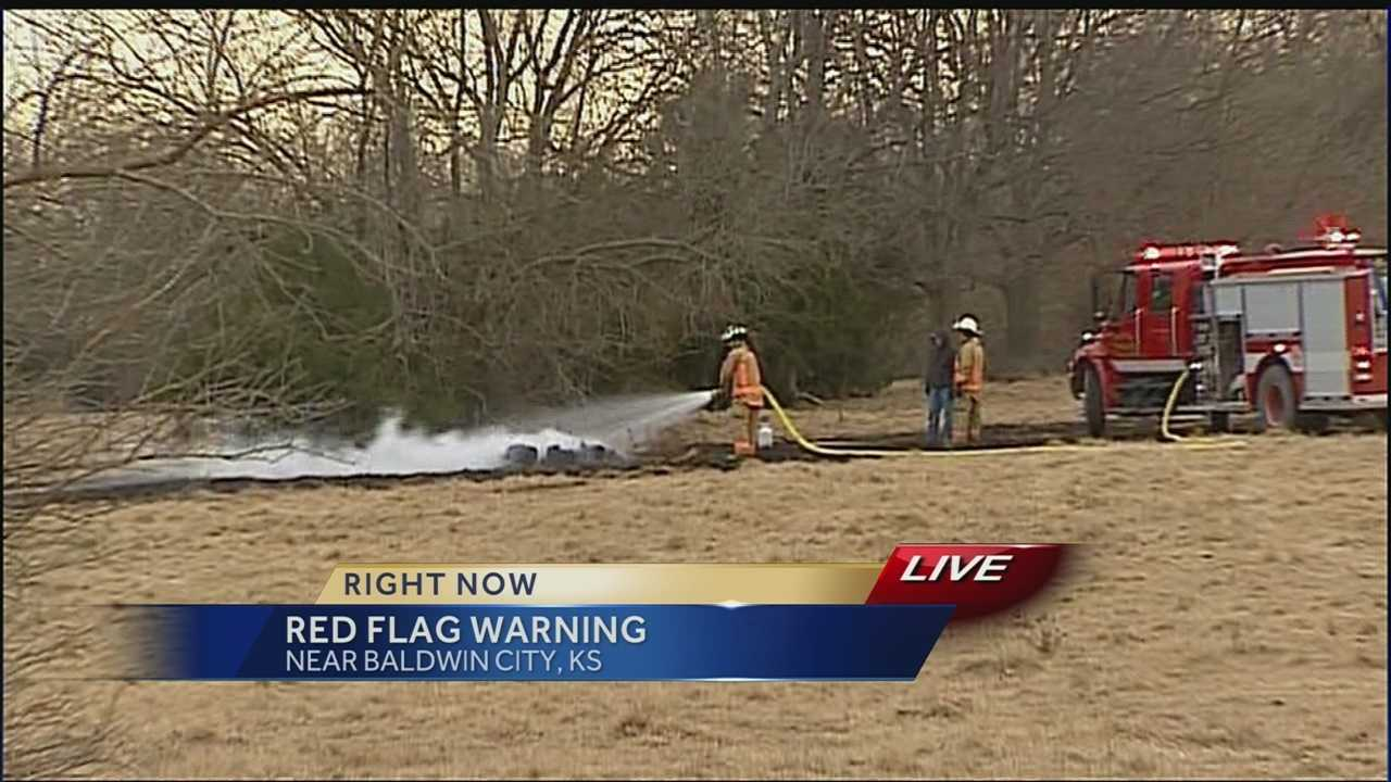 KMBC's Matt Evans reports from just north of Baldwin City, where a large brush fire burned about 50 acres.