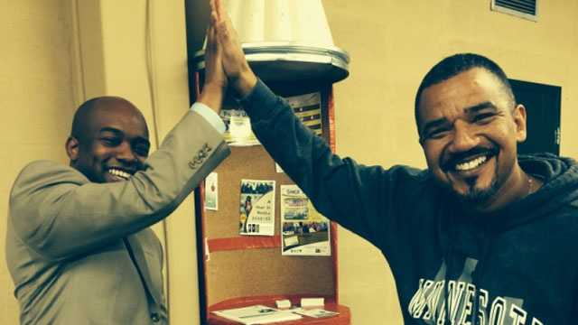"""Rep. Courtney Allen Curtis (left) demonstrates a """"high five"""" that he wants to be Missouri's official state greeting."""