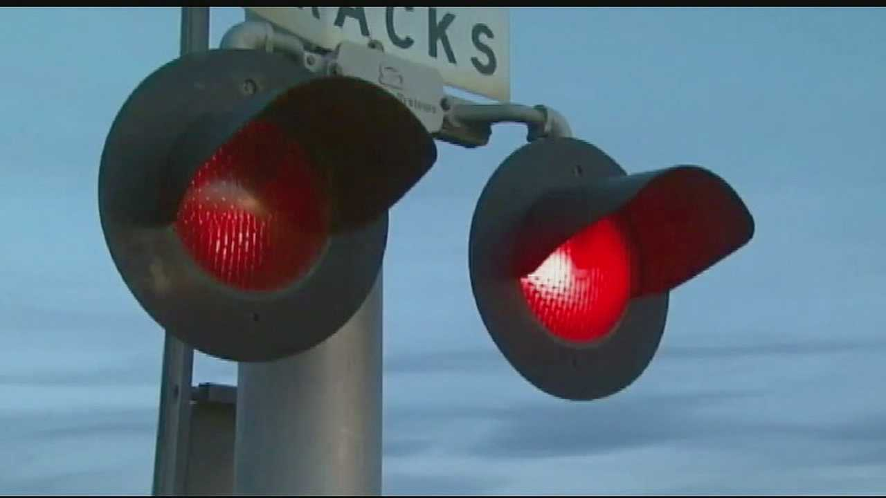 Image Generic railroad crossing lights, train