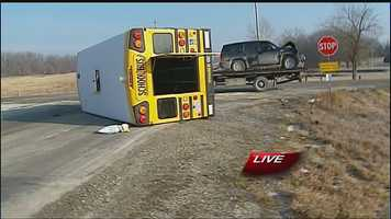 Images from a rollover crash involving a school bus and SUV at 223rd Street and Gardner Road in Miami County on Thursday morning.