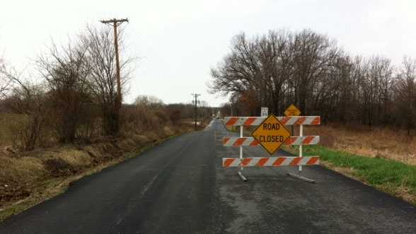 Image Warrensburg flooding - road closed sign