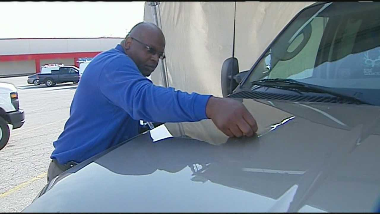 Insurance companies are keeping busy processing claims from auto damage after recent hail storms and at least one company has set up a drive-through service to keep up.