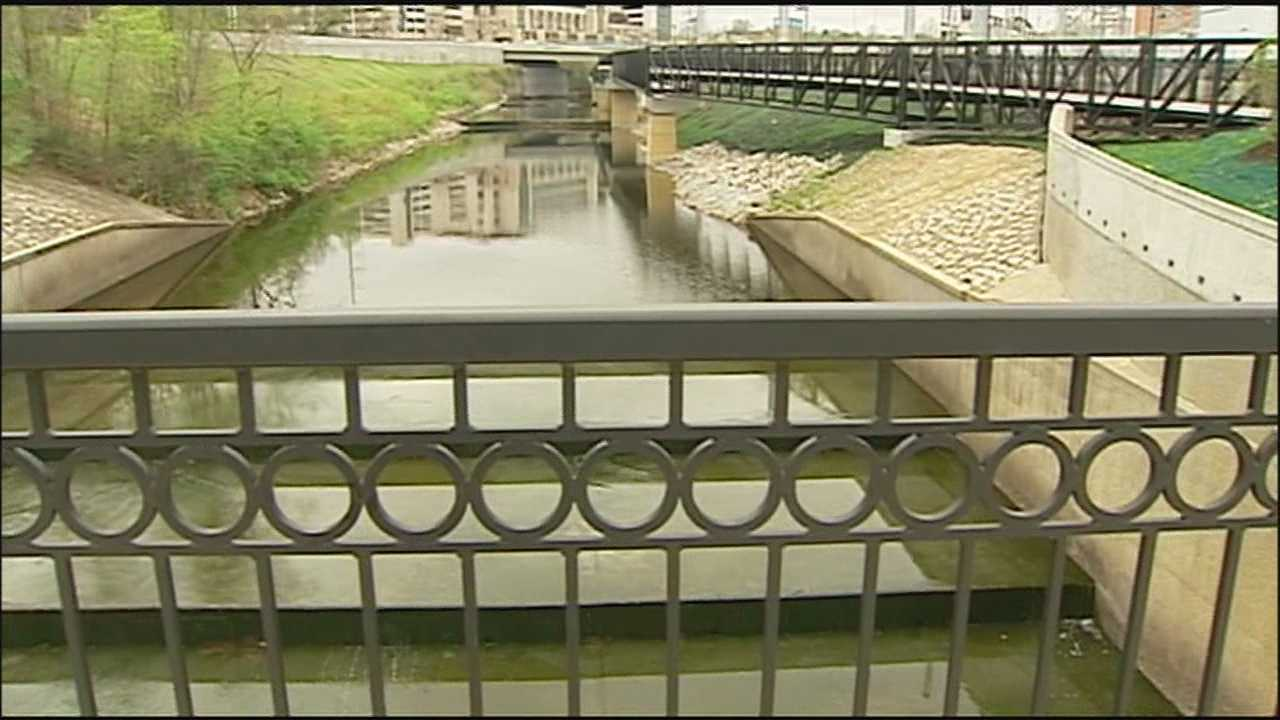 The opening of a pedestrian bridge over Brush Creek has wrapped up the projects funded by a $50 million Tiger Grant.
