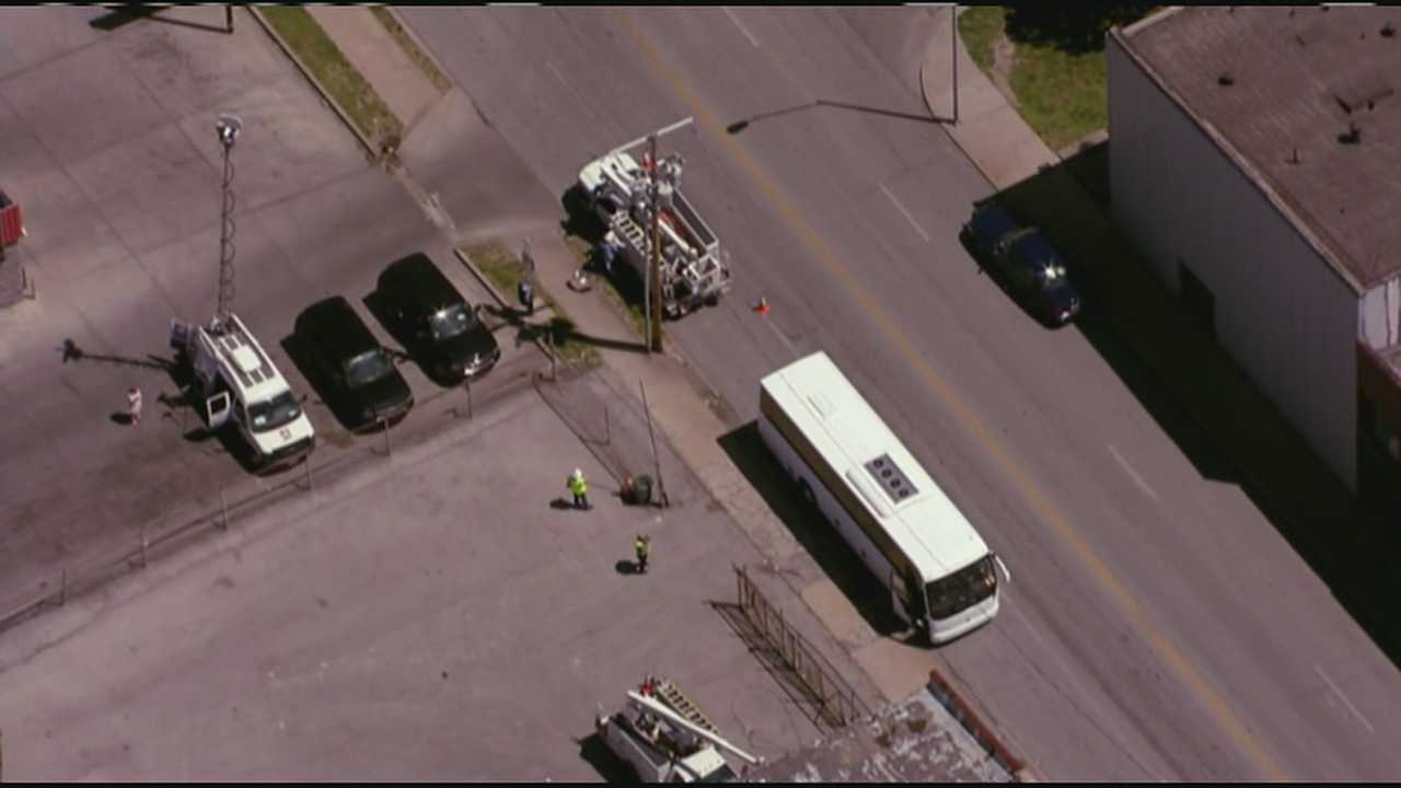 Charter bus hits power pole
